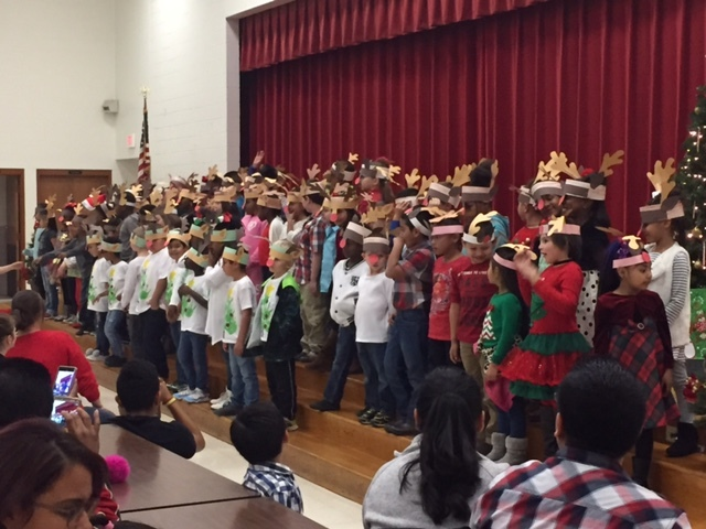 First graders offer holiday songs